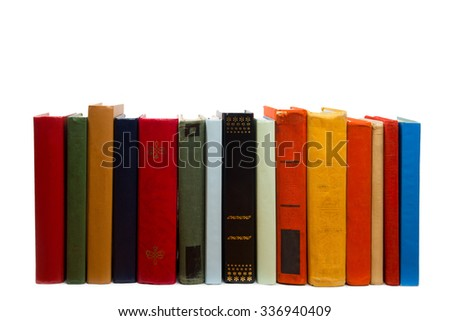 Stack of colorful books on wooden shelf isolated on white background. Back to school. Copy space for text - stock photo
