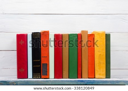 Stack of colorful books on wooden table. Back to school. Copy space for text - stock photo