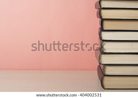 Stack of colorful books on wooden table. Education background. Back to school. Copy space for text.