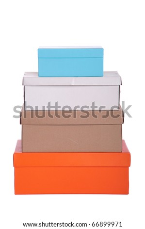 stack of colorful boxes isolated on white background - stock photo