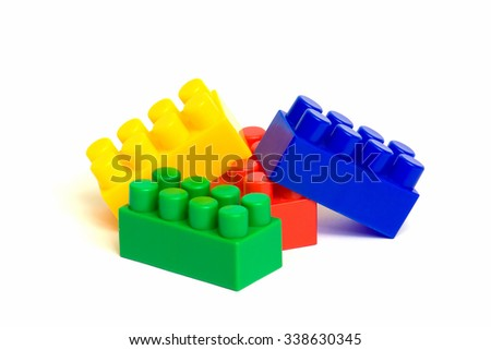 stack of colorful building blocks, plastic parts of children's play, NO VISIBLE TRADEMARKS