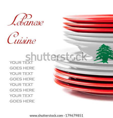 Stack of colorful ceramics plates on white background in white and red, colors of Lebanese flag, illustrating concept of Lebanese food and cuisine - stock photo