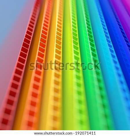 Stack of colorful corrugated plastic sheets close up view with depth of field - stock photo
