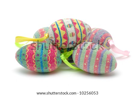 Stack of colorful easter eggs in isolated white background