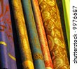 Stack of colorful Egyptian fabrics at market in Cairo, Egypt. - stock photo