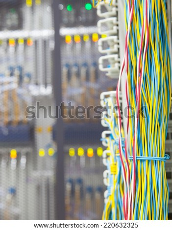 stack of colorful electronic wire in socket board of digital telecommunication control room  - stock photo