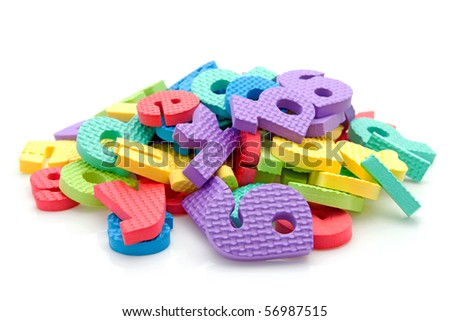 Stack of colorful foam letters over white background