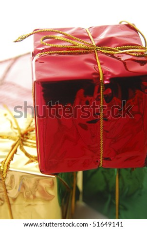Stack of colorful gifts isolated on white. - stock photo