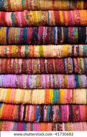stack of colorful hand-woven fabrics