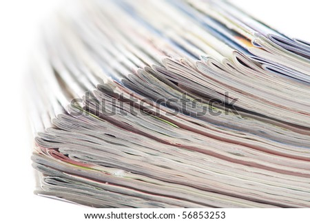 stack of colorful magazines or documents - paper edges background