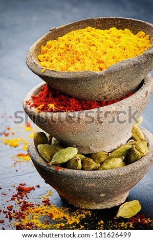 Stack of colorful mix of spices - stock photo