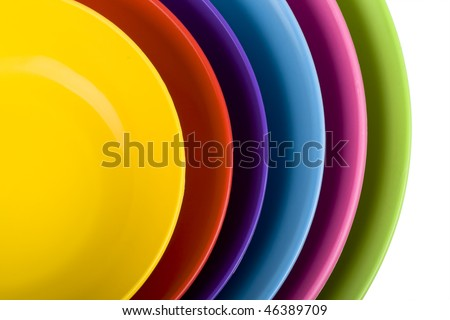 Stack of colorful plastic bowls over white background - stock photo