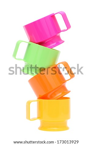 Stack of colorful plastic cups isolated on white background - stock photo
