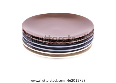 Stack of colorful plates isolated on white background.