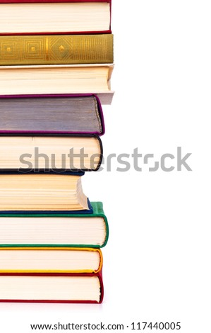 Stack of colorful real books on white background, partial view. - stock photo