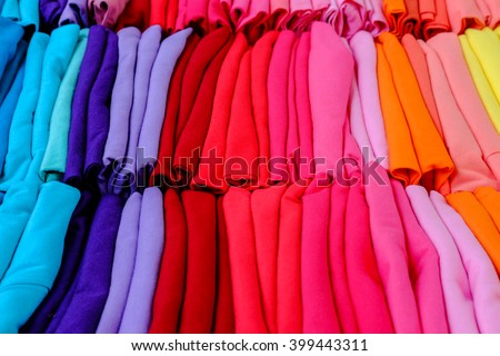 Stack of colorful t-shirts for sale - stock photo