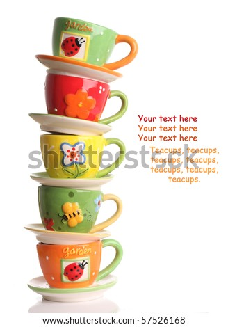 Stack of colorful teacups. - stock photo