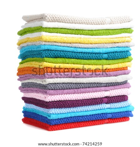 stack of colorful towels isolated on white background - stock photo