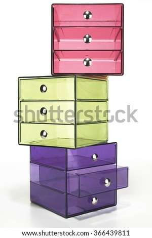 Stack of colorful transparent drawers on white background - stock photo