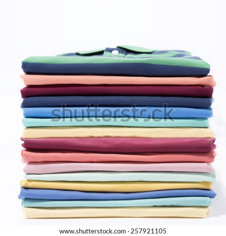 Stack of colourful t-shirt - stock photo