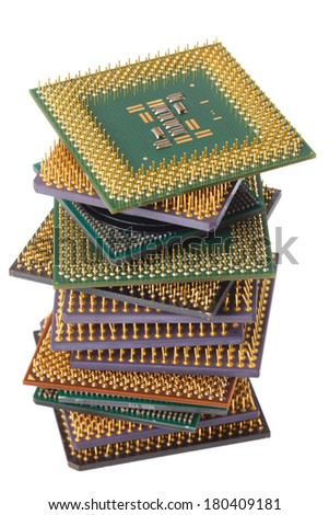 Stack of computer CPU processor microchips cut out on white background - stock photo