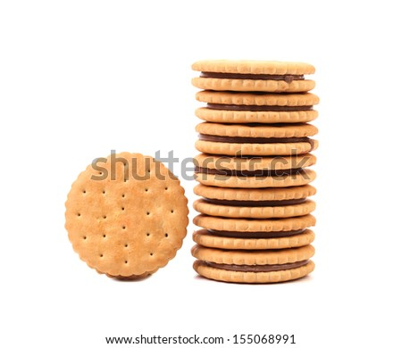 Stack of cookie biscuits with filling. Isolated on a white background
