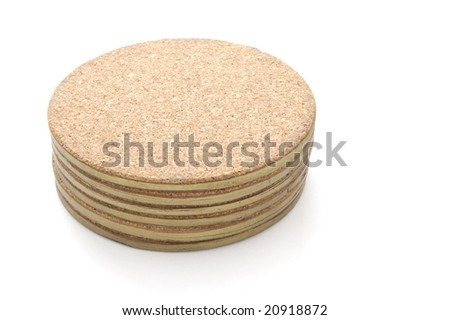 Stack of cork table coasters isolated on a white background