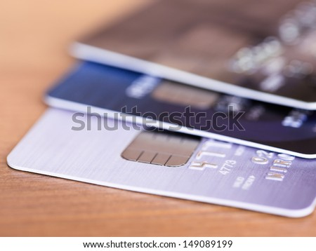 Stack of credit cards on wooden desk selective focus - stock photo