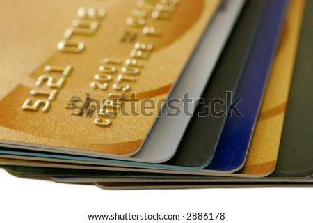 Stack of Credit Cards with shallow DOF (focus on cards tips) - stock photo