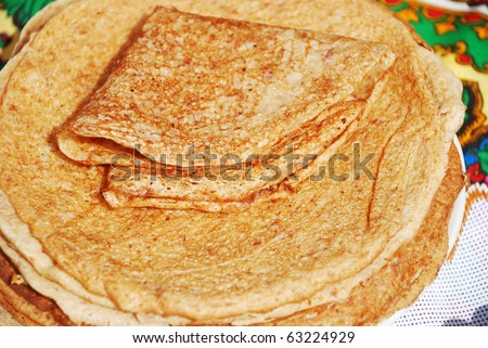 Stack of crepes on a plate - stock photo