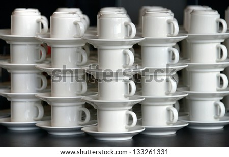 Stack of cups and saucers - stock photo