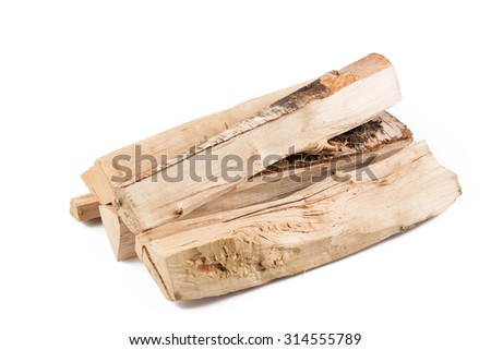 Stack of cut logs firewood from silver birch tree isolated on white background