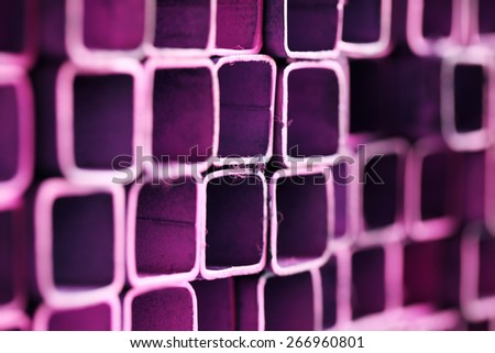 stack of cutting pipe as colorful grunge background. - stock photo