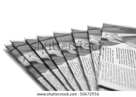 Stack of daily paper or newspapers over white (Shallow DOF) - stock photo