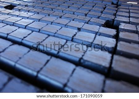 stack of dark coal briquettes - stock photo