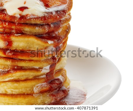 Stack of delicious pancakes with butter and strawberry jam isolated on white. - stock photo