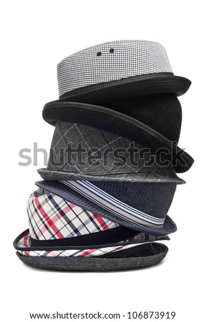 stack of different and trendy hats on a white background - stock photo