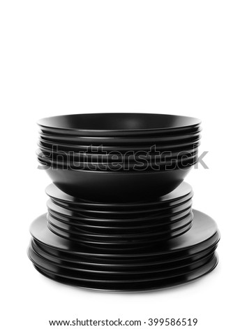 Stack of different black ceramic plates, isolated on white - stock photo