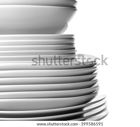 Stack of different ceramic plates, isolated on white - stock photo