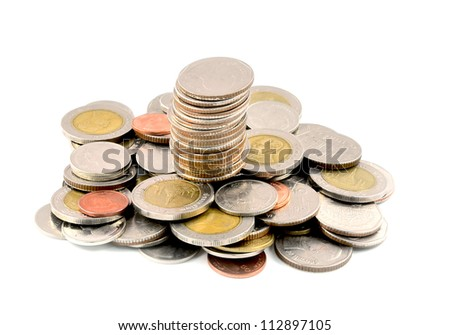 Stack of different coins taken closeup.
