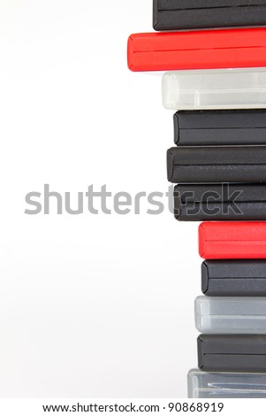 Stack of different colored DVD cases in front of a white background - stock photo