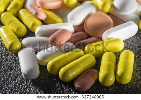 Stack of different colorful pills