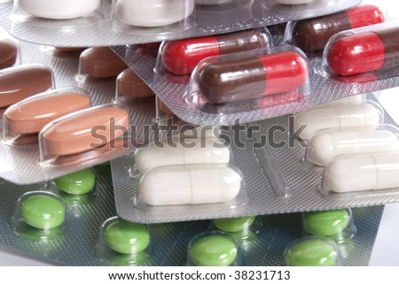 stack of different colorful pills in packs - stock photo
