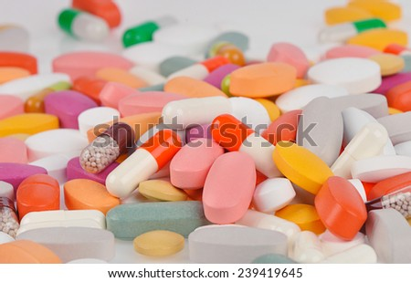 Stack of different pills - stock photo
