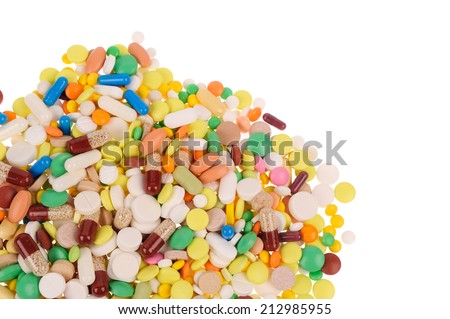 Stack of different pills on white background  - stock photo