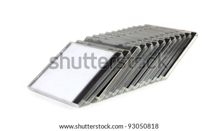 stack of disk cases on white background with clipping path - stock photo