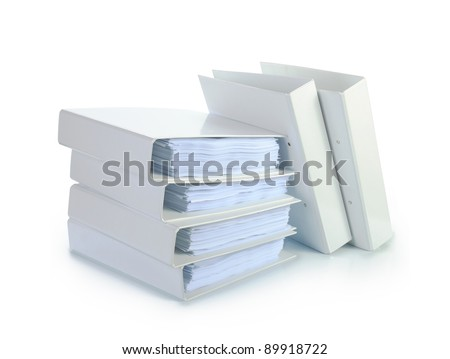 Stack of documents binders against white background