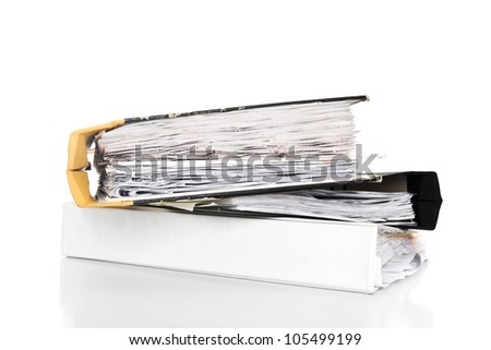 Stack of documents in binders against white background - stock photo