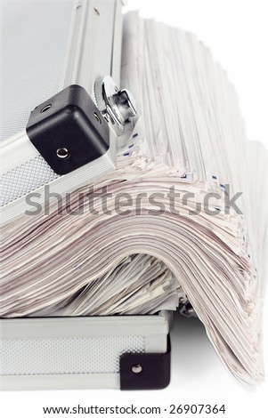 Stack of documents in briefcase