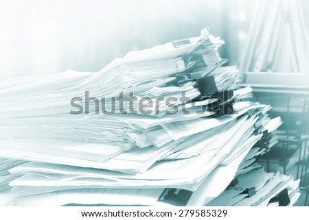 Stack of documents on the table with soft focus - stock photo